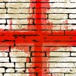 Grunged English Cross of Saint George Flag over a brick wall  — Stock Vector