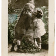 Royalty-Free Stock Photo: Vintage Postcard Young Kids in Love