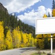 Blank Billboard Along Mountain Road in Fall — Stock Photo