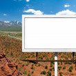 Billboard Sign on Empty Highway in Desert — Stock Photo