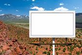 Billboard Sign on Empty Highway in Desert — Stock Photo