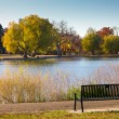 Empty Park Bench by a Lake in Fall - Denver — Stock Photo