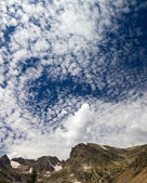 Swirling Clouds Above the Mountains — 图库照片