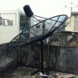 Receiving satellite dish on the roof — Stock Photo
