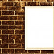 Blank frame on brick wall — Stock Photo