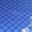 Metal mesh and blue sky - Stock Photo