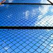 Royalty-Free Stock Photo: Metal mesh and blue sky