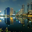 Stock Photo: Bangkok in evening, reflection of buildings in water