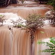 Turbid water of tropical waterfall after hard rain — Stock Photo