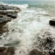Waves swashing stone in tropical sea — Stock Photo