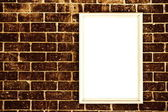 Blank frame on brick wall — Stock Photo