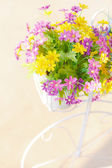 Colorful artificial flowers — Stock Photo