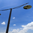Street lamp and blue sky — Stock Photo