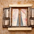 Stock Photo: Wood window on wall