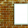 Blank wood frame on brick wall — Stock Photo