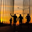 Runners run on bridge in the morning — Stock Photo