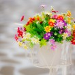 Fake hand and artificial flower — Stock Photo