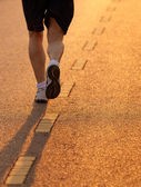 Feet of runner in evening light — Stock Photo