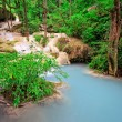 Limestone waterfall in tropical forest - Stock Photo