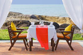 Dinner table beside beach — Stock Photo