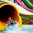 Boy playing in water park — Foto Stock