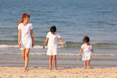 Asian family on beach — Stock Photo