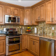 Kitchen mocha wood cabinetry — Stock Photo #21168739