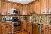 Kitchen mocha wood cabinetry — Stock Photo