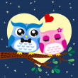 Stock Vector: Owls couple in love at tree