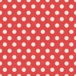 Seamless red polka dots pattern — Stock Vector