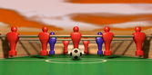 Foosball Table One Team On A Red Sky — Stock Photo