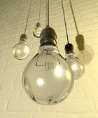 Hanging Light Bulbs And Fittings On A Wall — Stock Photo