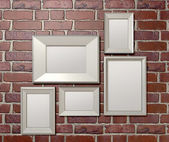 Blank Picture Frames On A Wall Front — Stock Photo