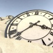 Stock Photo: Antique Clocks In Desert Sand Closeup