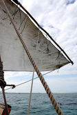 Dhow Sail On Blue Water In Zanzibar — Stock Photo