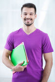 Teenage student with folders — Stock Photo