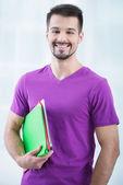 Teenage student with folders — Stock Photo