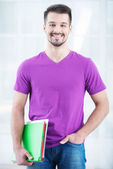 Teenage student smiling with folders — Stock Photo