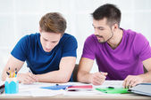 Students taking notes in classroom — Stock Photo