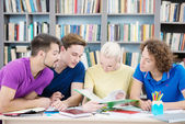 Students reading new information in classroom — Stock Photo