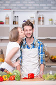 Young couple cooking together in kitchen — Stock Photo