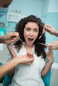Scared young woman at dentist appointment — Stock Photo