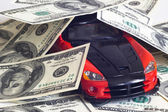 Sports car and money — Stock Photo