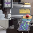 Engraving machine for material processing with a remote control - Stock Photo