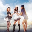 Three sexy sailor women standing in the port — Stock Photo