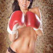Cute woman boxing topless wearing black panties - Foto Stock
