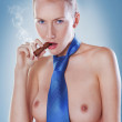 Cute woman smoking a cigar topless dressed with tie — Stock Photo