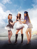 Three sexy sailor women standing in the port — Stockfoto