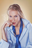 Cute woman smoking a cigar dressed with tie and shirt — Stock Photo