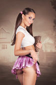 Sexy schoolgirl holding a book and lifting her skirt showing but — Stock Photo